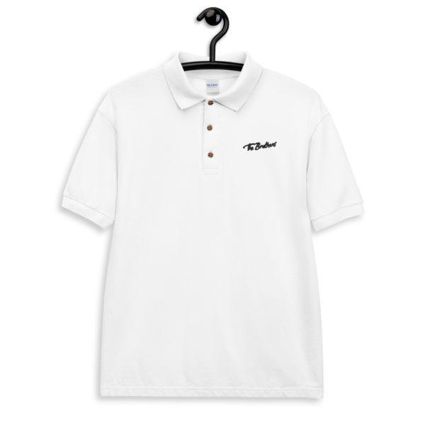 classic-polo-shirt-white-front-60b04ccf18588.jpg
